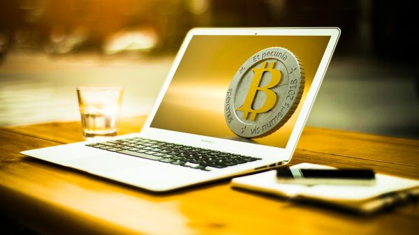 MacBook Air with Bitcoin logo as wallpaper