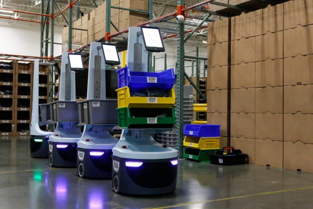 Collaborative robots inside a warehousing facility.