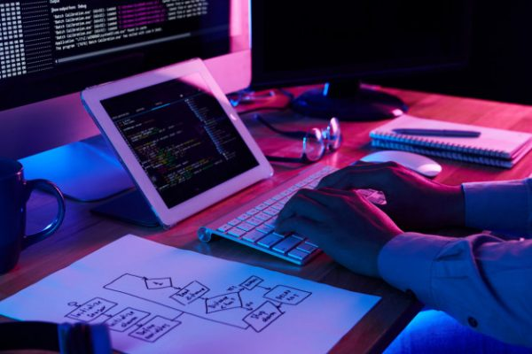 Programmer progamming and coding on desktop