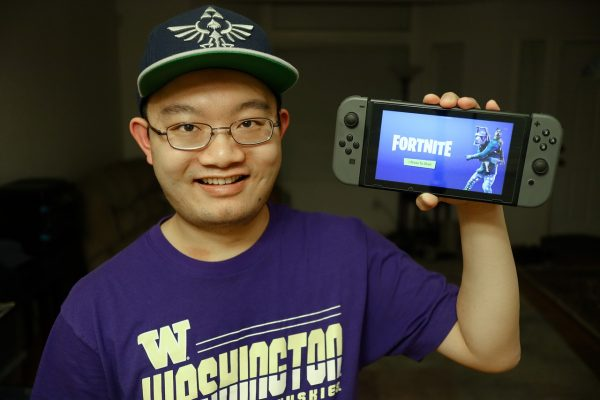 gamer holding switch