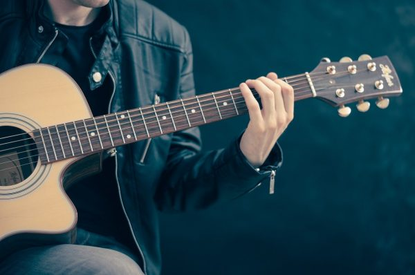 guitarist playing a song
