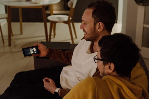 How to download movies on Hulu and Two men watching a movie on a mobile phone