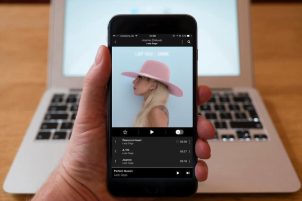 Using iPhone smartphone to display Tidal music streaming service with Lady GaGa album playing