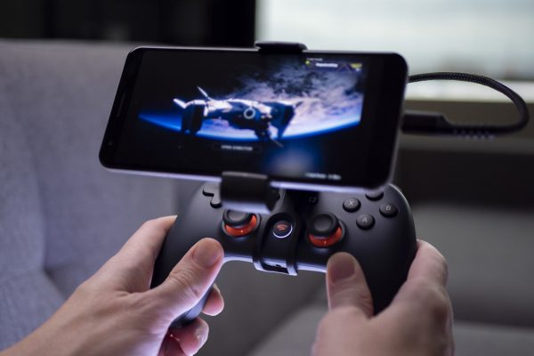 Playing games on a mobile phone with Google Stadia.