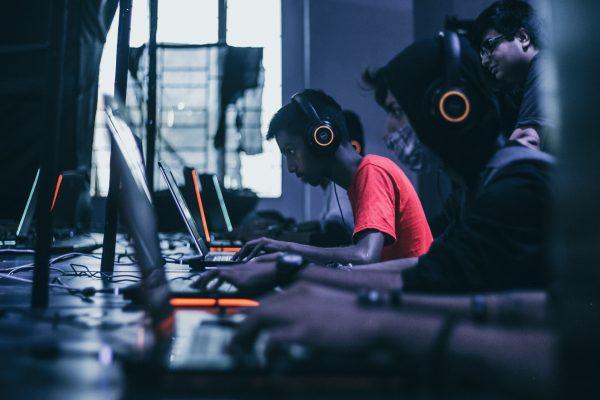 men playing games on their laptop