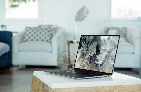 Ultra-thin laptop sitting on a small table in a living room